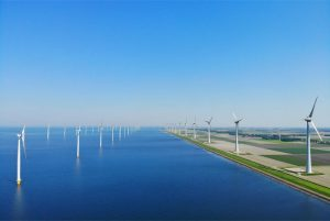 Faccin: onshore and offshore wind farm with wind turbines for green energy production