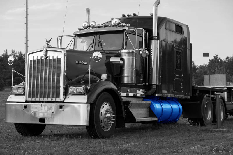 Faccin: white & black truck image with a blue fuel tank