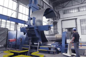 Faccin: blue plate bending machine with perfectly rolled can in a factory for wind tower production